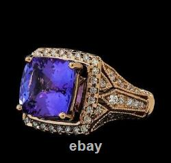 14kt Rose Gold 5.9 Ct. Tanzinite and. 84 Ct. Diamond Certified Ring