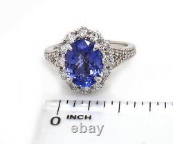 2.74 CT Tanzanite & 1.12 CTW Diamond Halo Ring in 14K, Certified